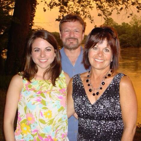 Claire (left) with mom and dad, Greg and Laurie